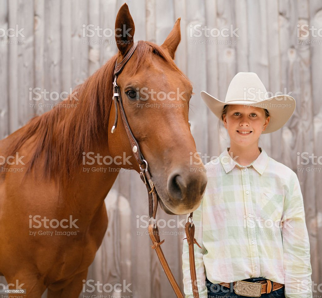 Western Riding Young Girl with her Horse stock photo