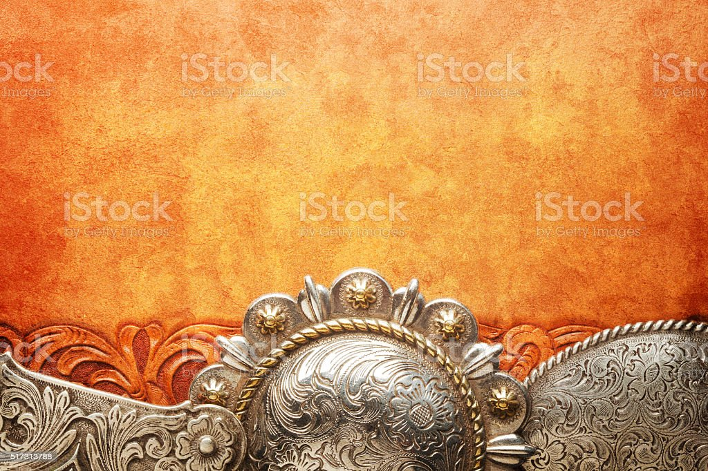 Western Style Belt Buckles On Tooled Leather Surface stock photo