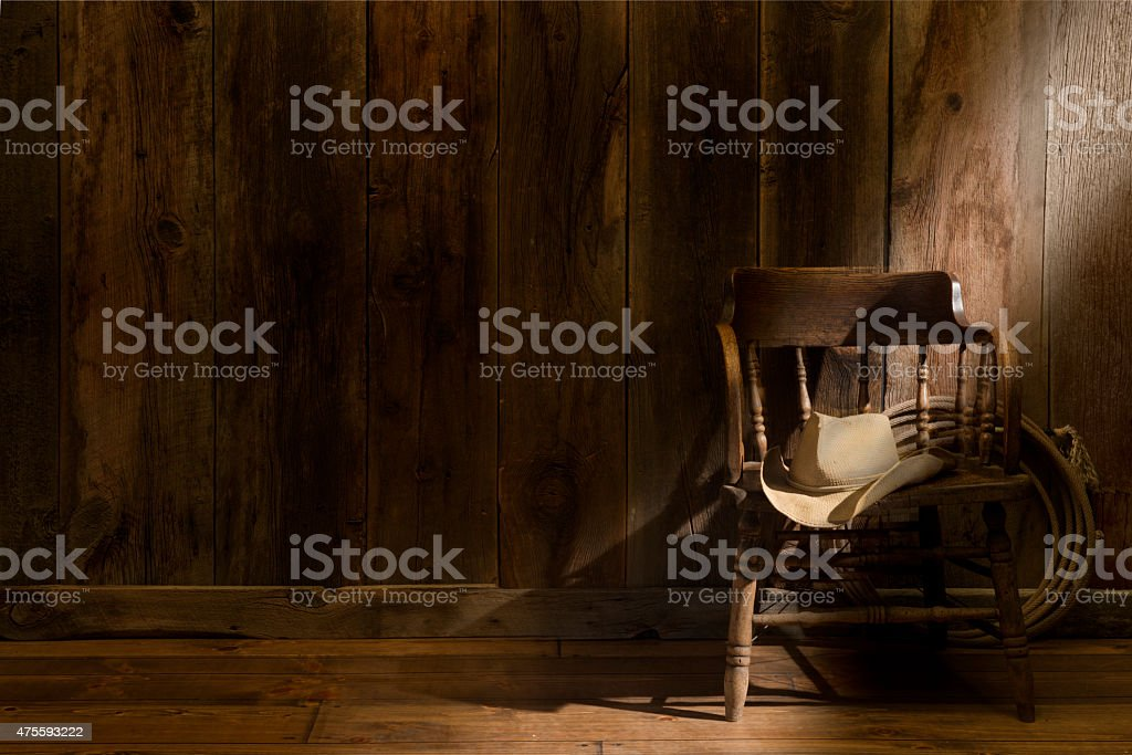 Western theme with rustic barnwood and saloon chair stock photo