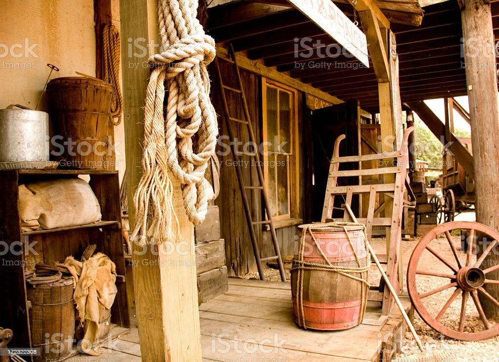 Western town boardwalk with livery items on display stock photo