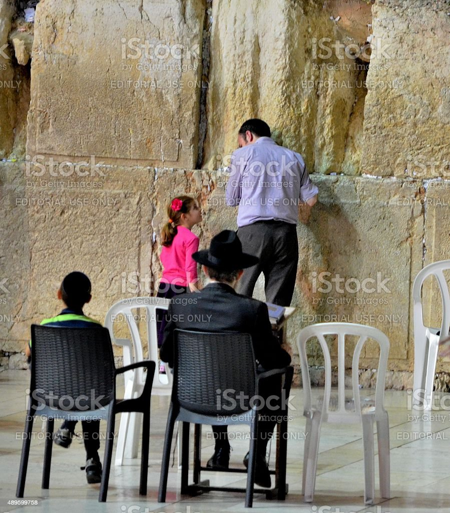 Western Wall, Faith: father teaches his daughter how to pray stock photo