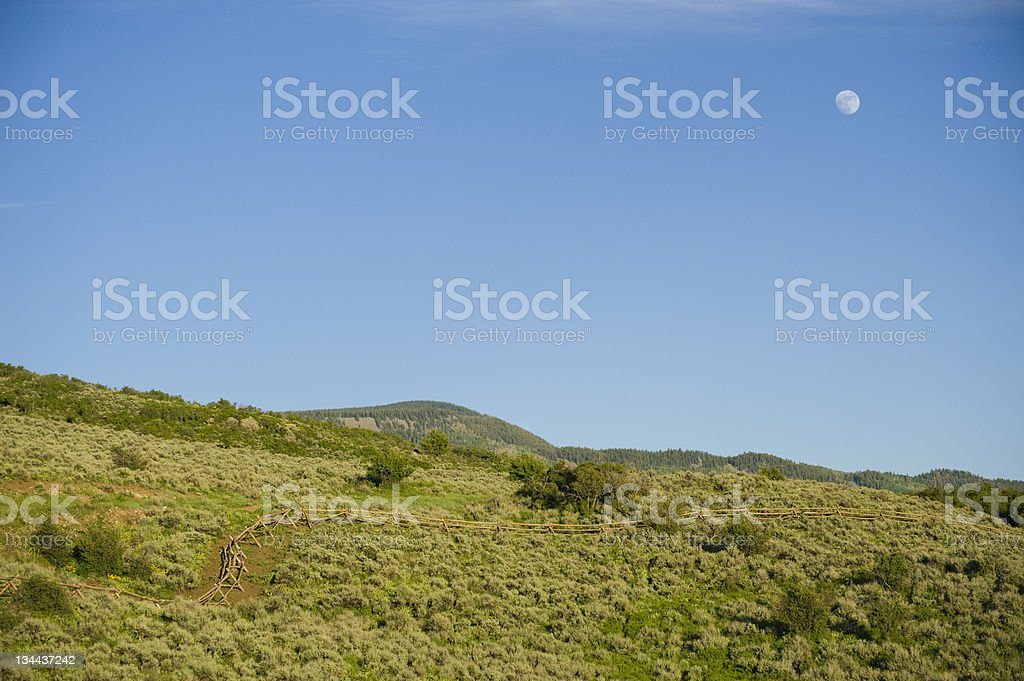 Western Wood Fence and Moon Landscape stock photo