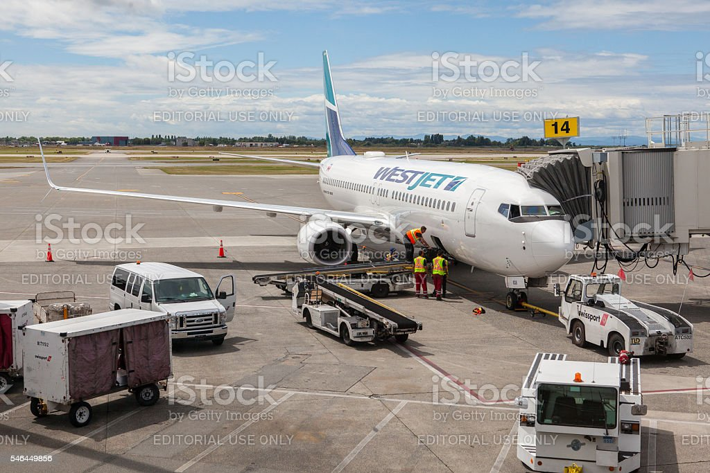 Westjet Airplane at Vancouver International Airport stock photo