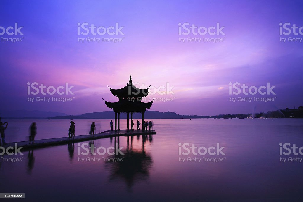 Westlake temple with sunset in Hangzhou stock photo