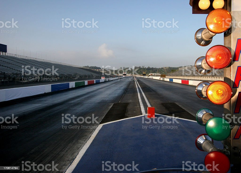 A wet and empty drag racing track stock photo