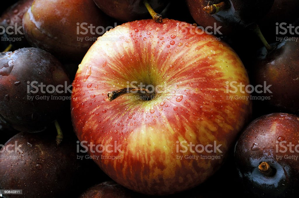 Wet apple and English plumbs fruit nutritious background stock photo