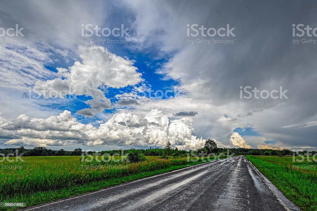 Wet backcountry road after heavy rainstorm stock photo