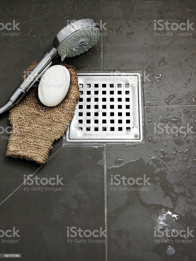 Wet bathroom with bathing utensils on the floor stock photo