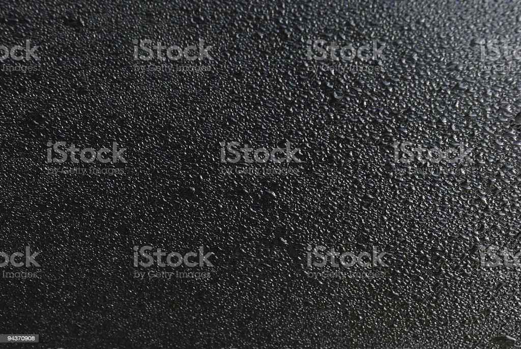 wet black metal stock photo
