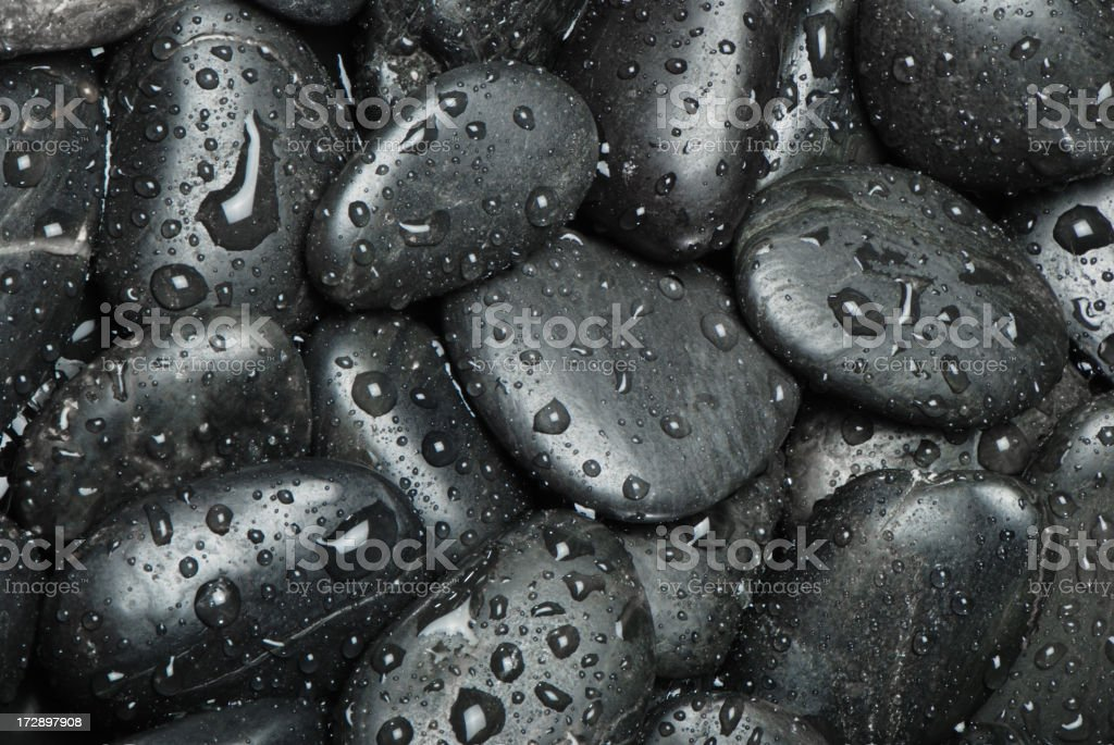 Wet black pebbles royalty-free stock photo