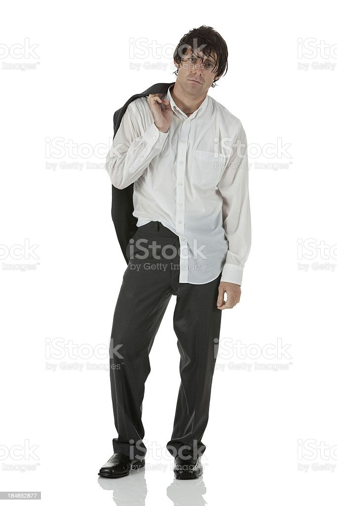 Wet businessman carrying coat on shoulder royalty-free stock photo
