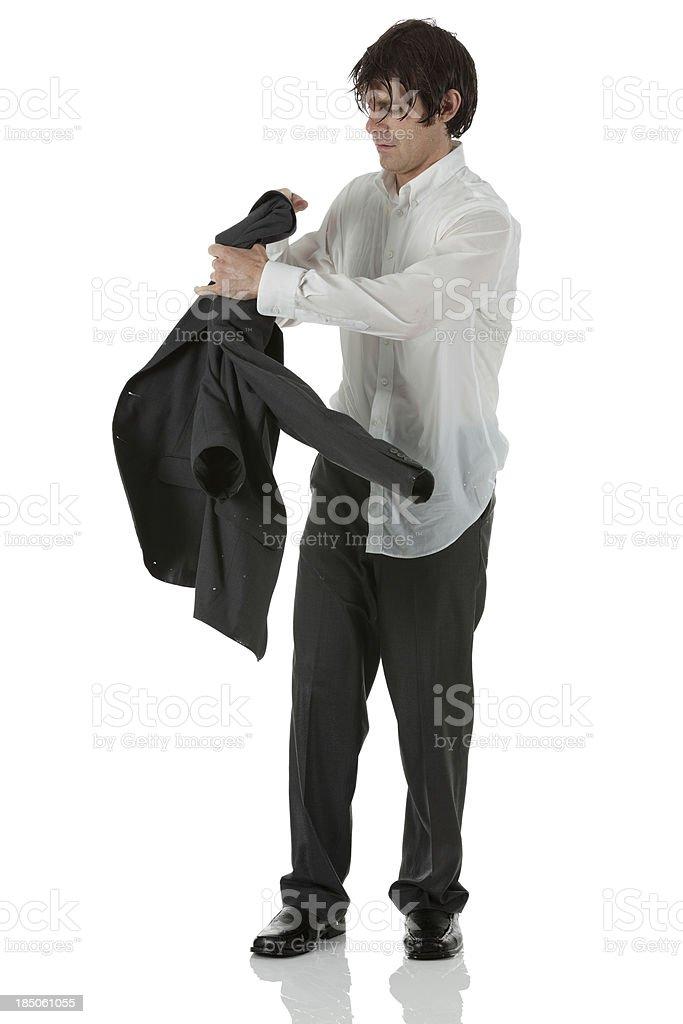 Wet businessman holding coat royalty-free stock photo