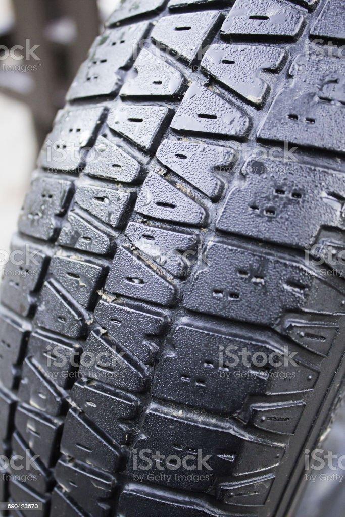 Wet car tire stock photo