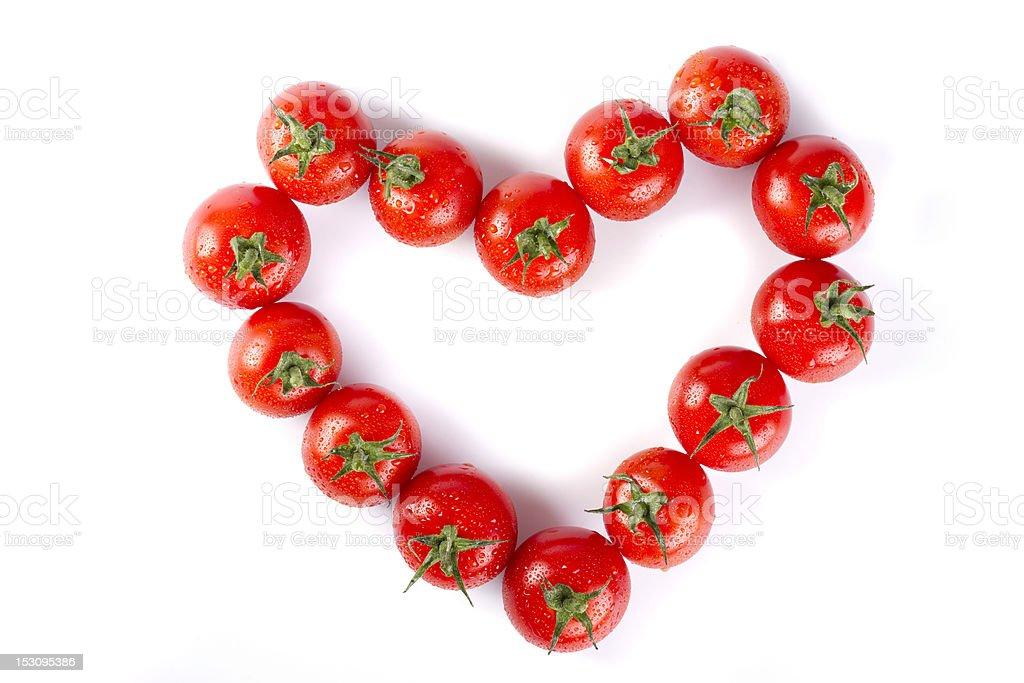 wet cherry tomatoes heart stock photo