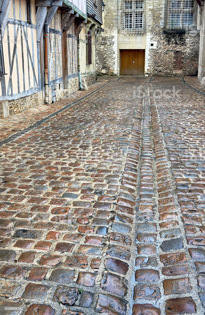 wet cobbled street in old town of Troyes stock photo