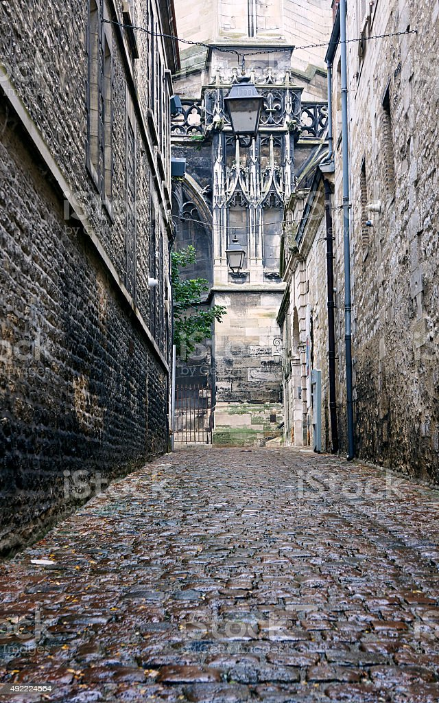 wet cobbled street in old town stock photo