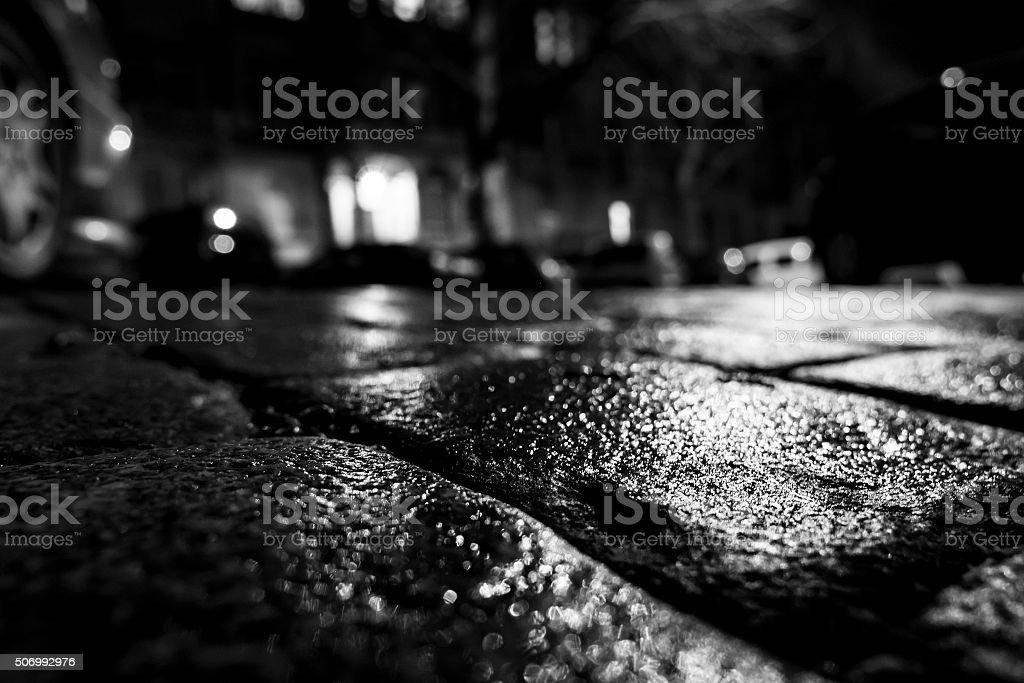 Wet cobblestones low-angle view nightshot stock photo