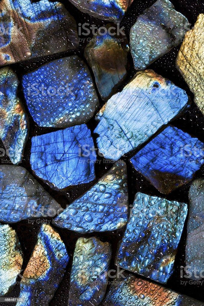 Wet colorful labradorite gem stones. stock photo