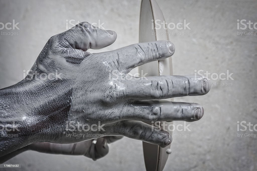 Wet, creative hands holding ceramic plate ready for glazing. royalty-free stock photo