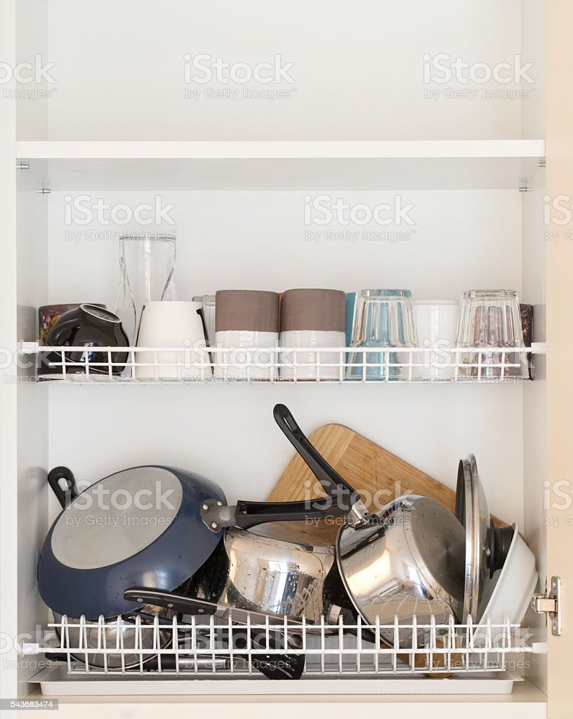 wet dishes in the dish draining closet stock photo