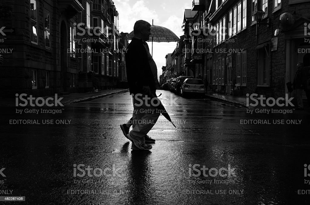 Wet downtown Quebec city street evening stock photo