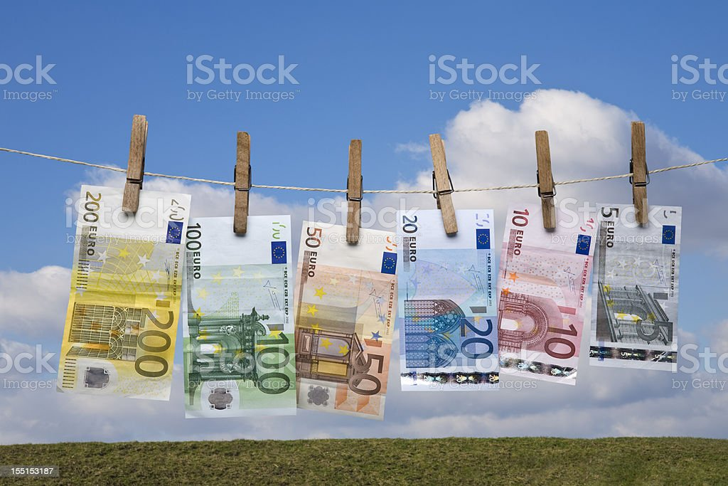 Wet Euro banknotes hanging on a clothes line stock photo