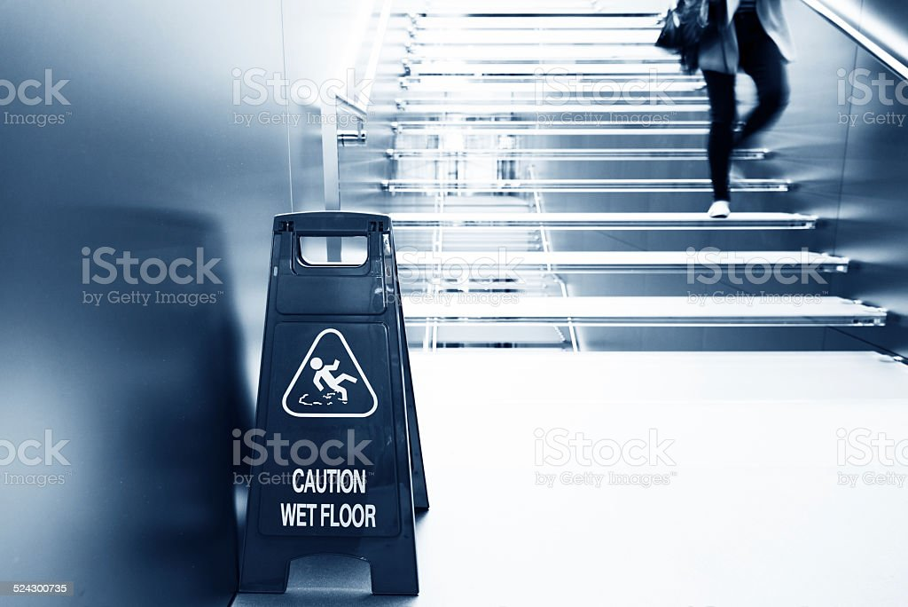 wet floor caution stock photo