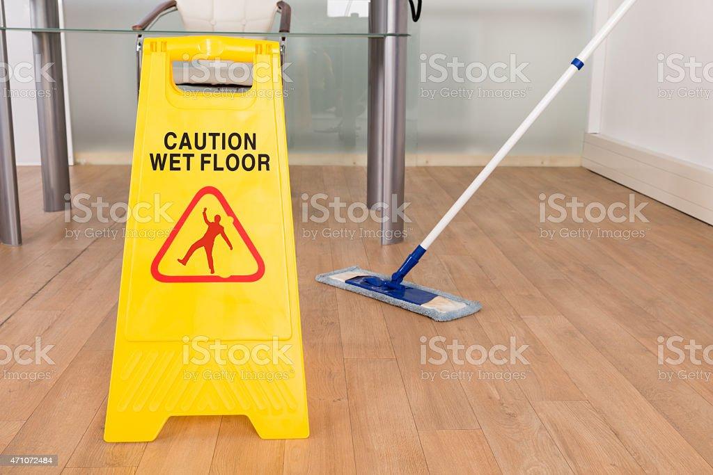 Wet Floor Sign And Mop stock photo