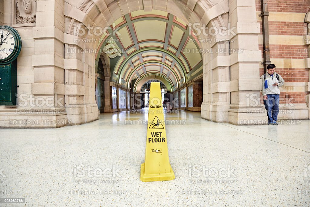 Wet floor sign in station building stock photo
