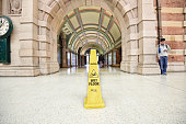 Wet floor sign in station building