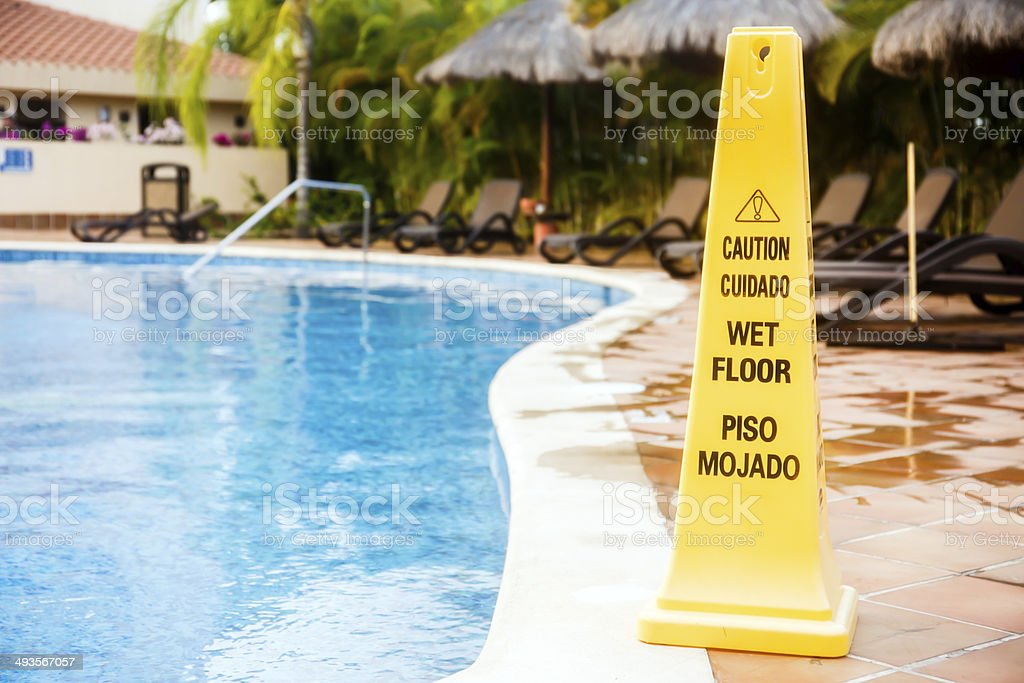 Wet floor warning stock photo