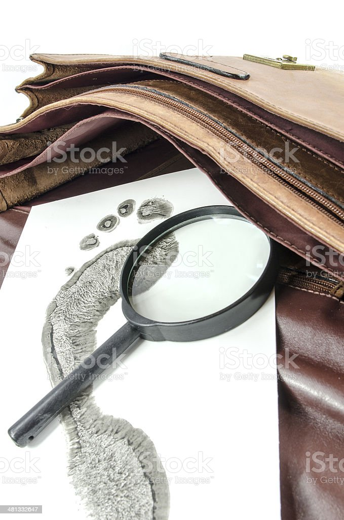 Wet footprint evidence with magnifying glass royalty-free stock photo