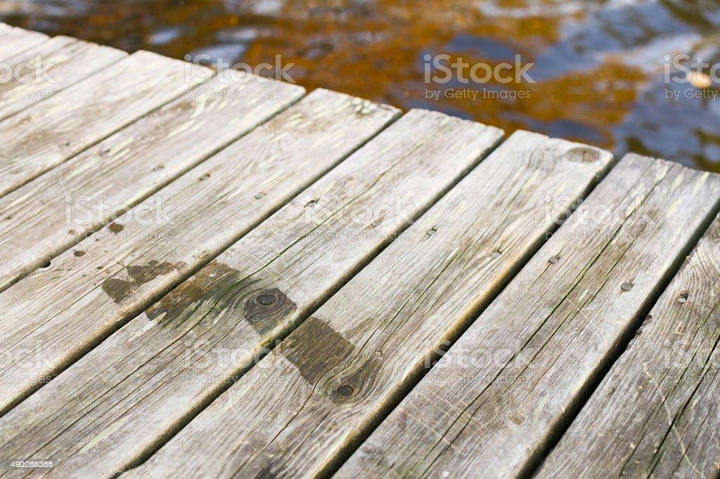 Wet Footprint on a Wooden Bridge stock photo