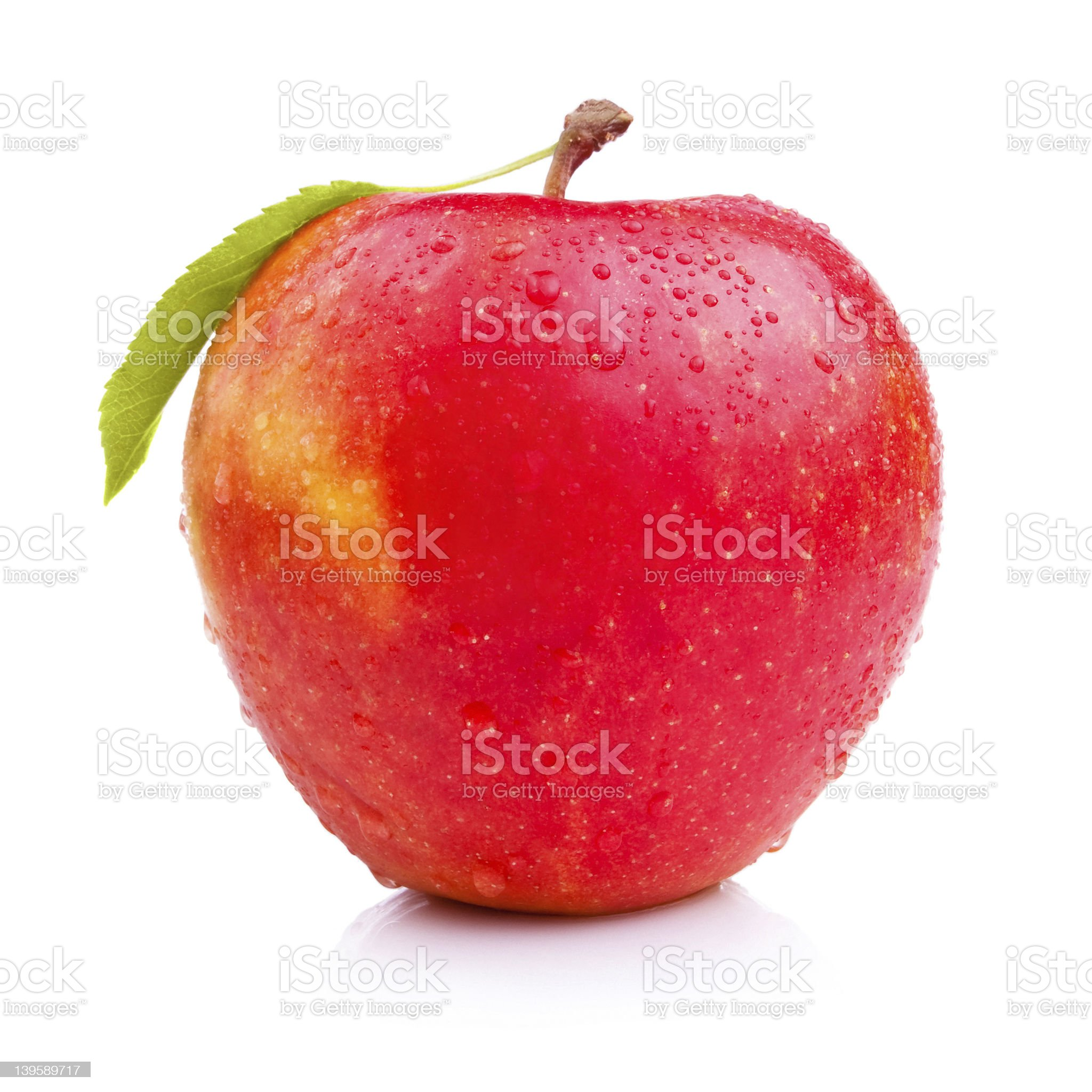 Wet fresh red apple with leaf isolated on white background royalty-free stock photo