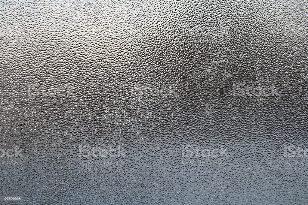 Wet glass with drops of water in black and blue gradient royalty-free stock photo