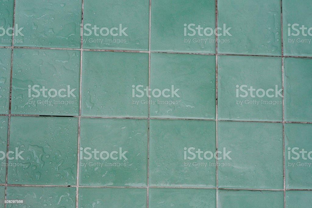 Wet green tile stock photo