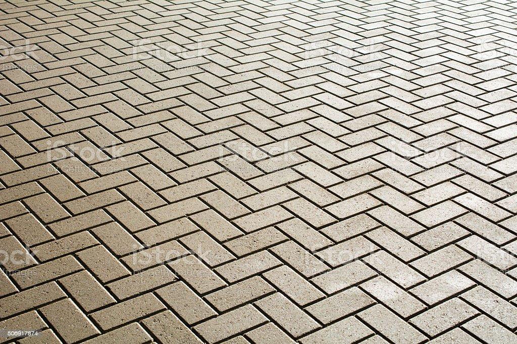 wet grey pavement fishbone pattern background stock photo