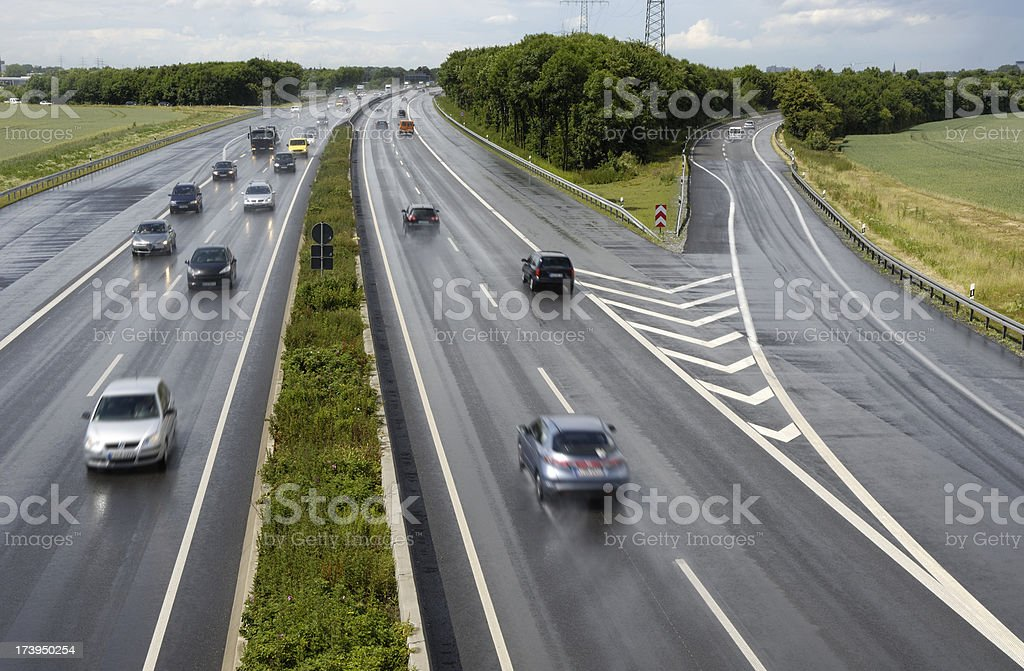 Wet highway with cars right after the rain royalty-free stock photo