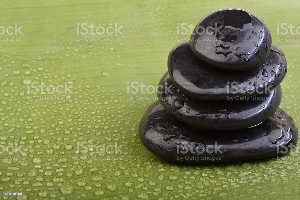 wet hotstones on green banana leaf royalty-free stock photo