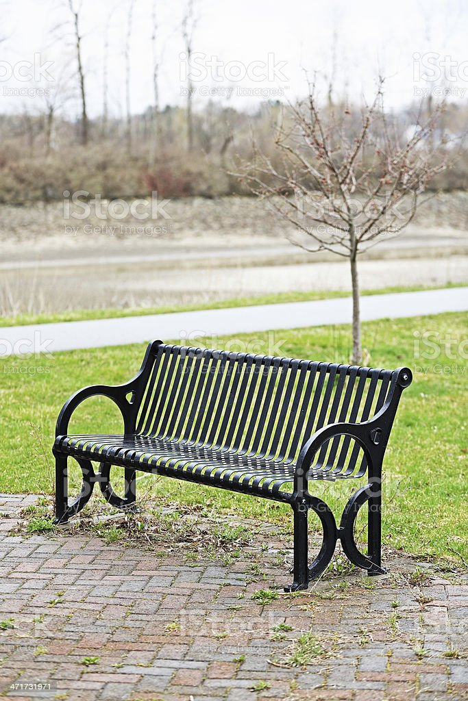 Wet Late Winter Park Bench stock photo