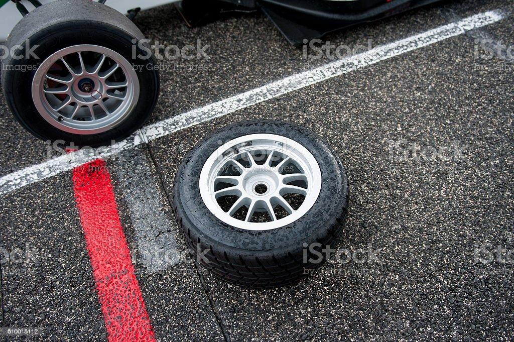 Wet motor sport racing tire on circuit track stock photo