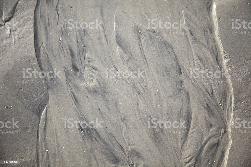 Wet mud and smooth send stock photo