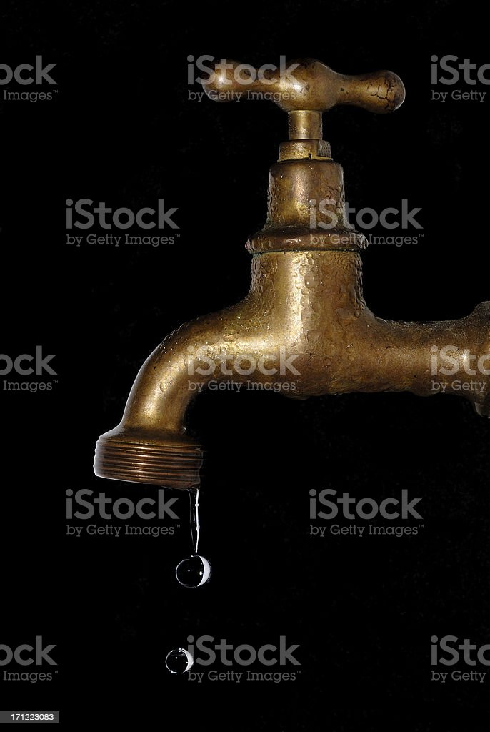 Wet, old leaking tap stock photo