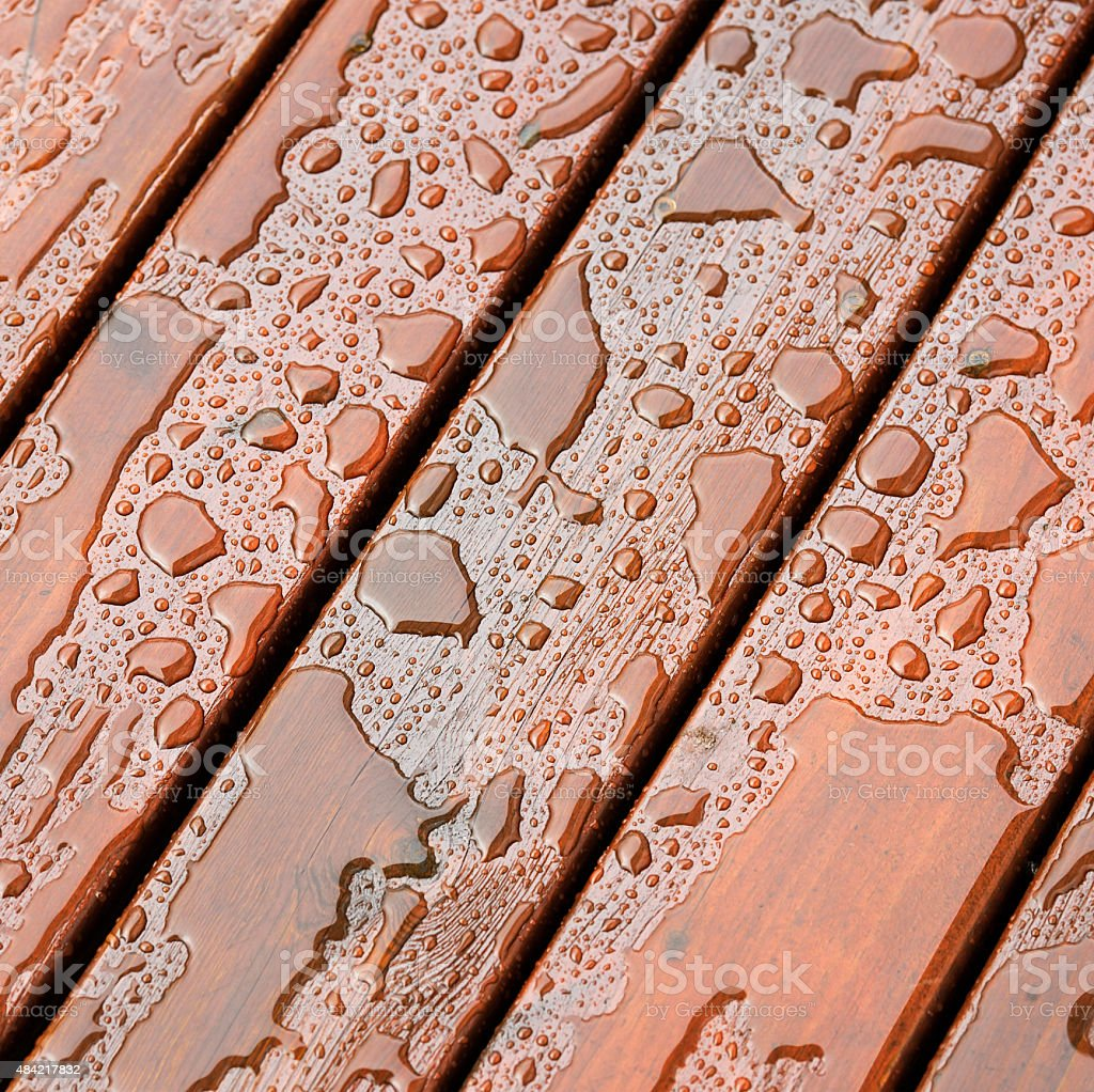 Wet outdoor decking surface after rain stock photo