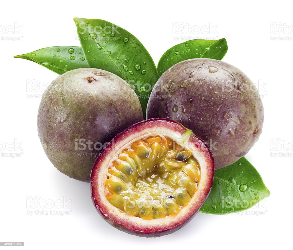 Wet passion fruits with leaves isolated on white stock photo