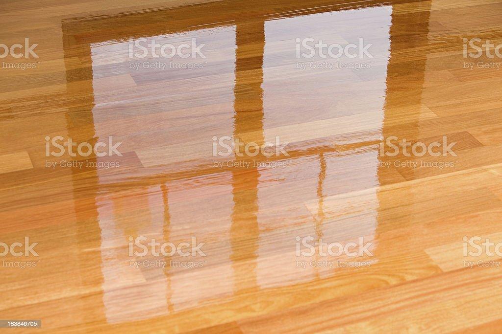 Wet Polyurethane on New Hardwood Floor with Window Reflection stock photo