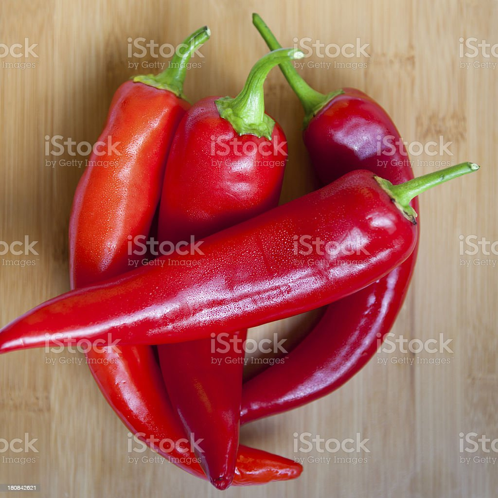 Wet Red Chili Peppers On A Cutting Board royalty-free stock photo