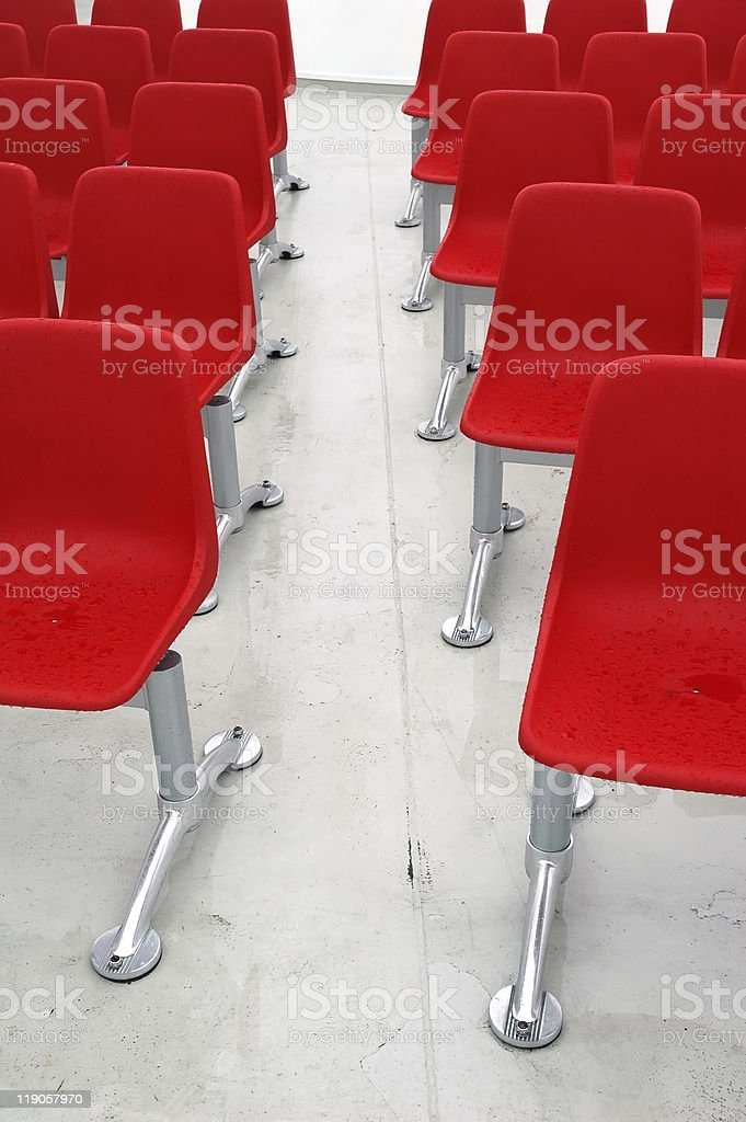 wet red modern stools outside stock photo