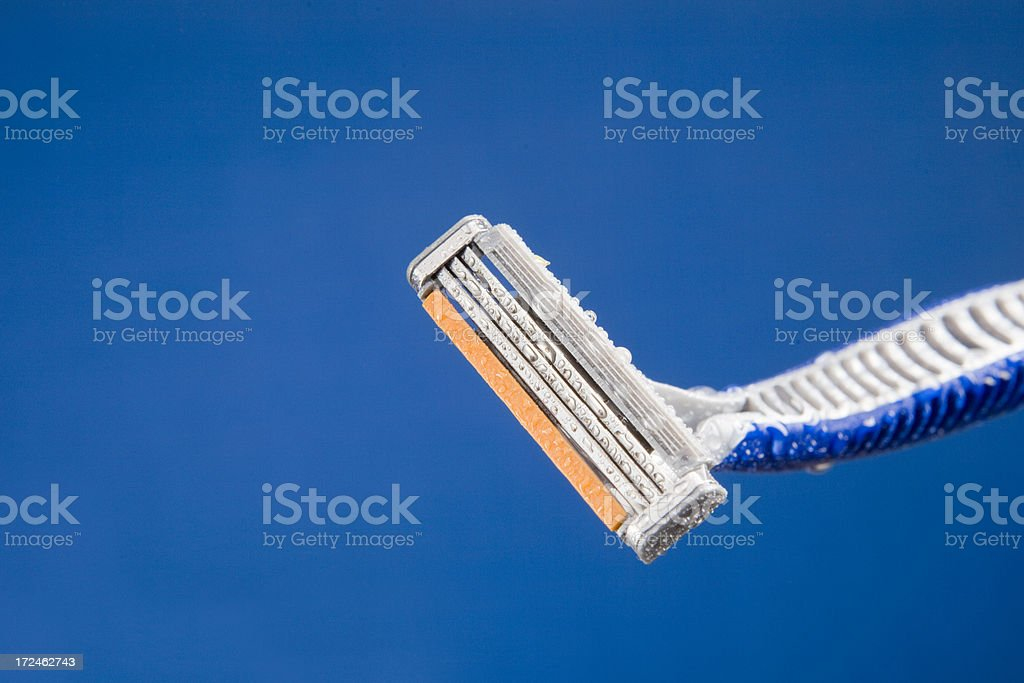 Wet shaver on a blue background royalty-free stock photo