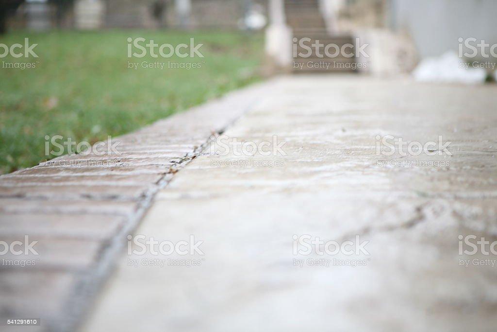 Wet sidewalk stock photo